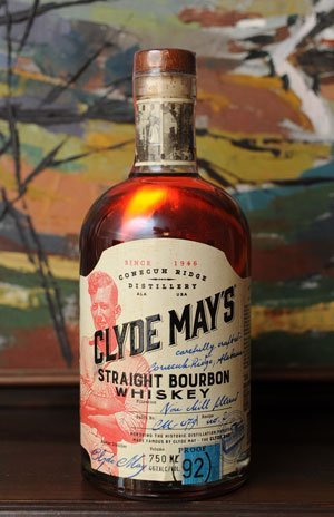 The original flat-faced bottle has been replaced by a round bottle featuring Clyde's photo