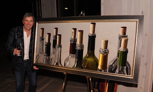 Thomas Arvid hosted the reception before hand, unveiling a work that was to be auctioned off for charity. The painting features wines from the current and previous Vintner's Dinner sponsors.